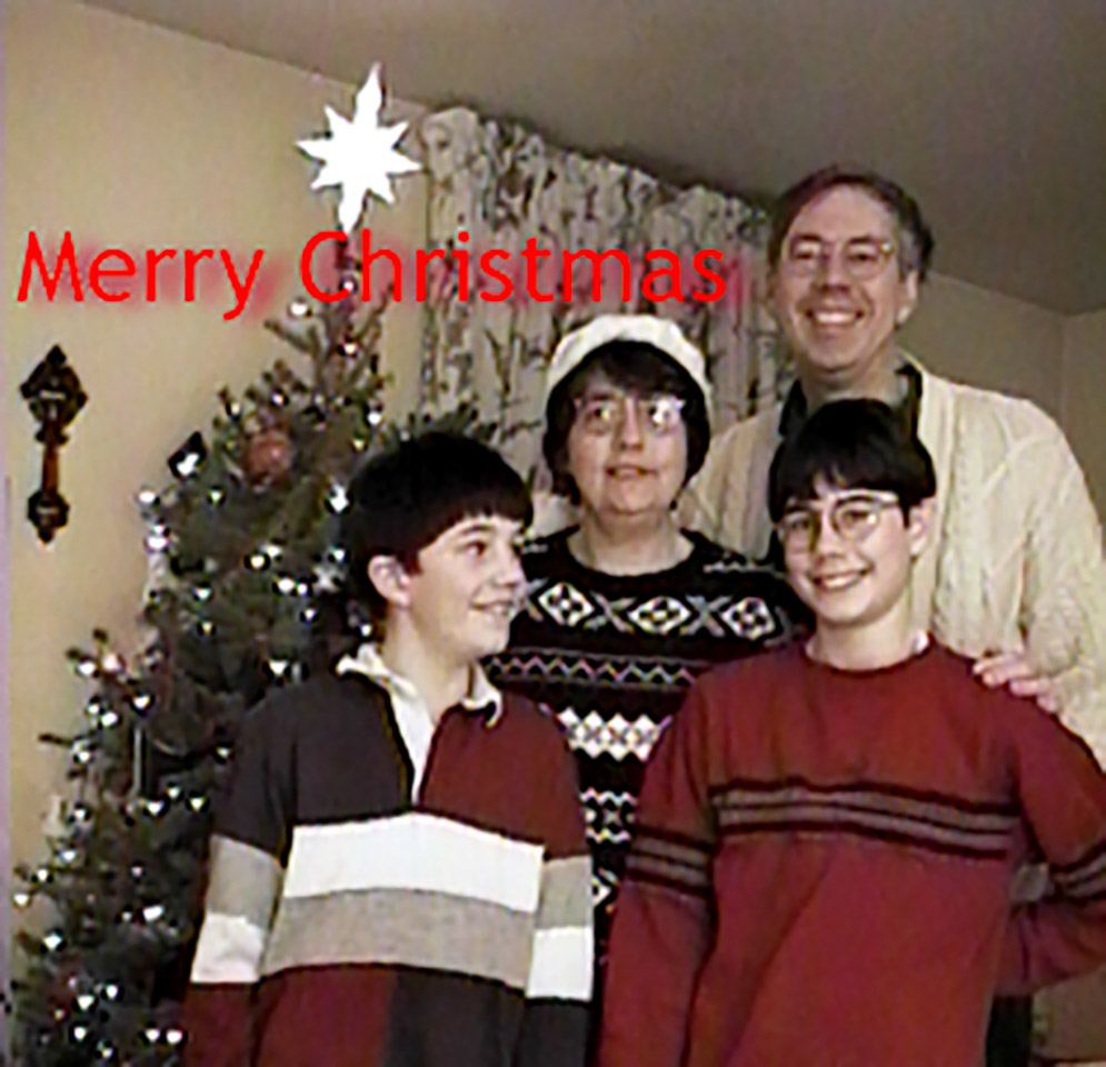 1998-12-25 Family Christmas Portrait. Michael, Catherine, Richard and Conrad (from video image)