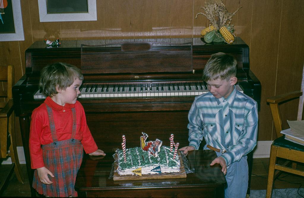 2005-01-20  Happy Birthday, Ray!  Retro: 1964-01-20.  Lynn and Ray admire Mom's  football cake creation.